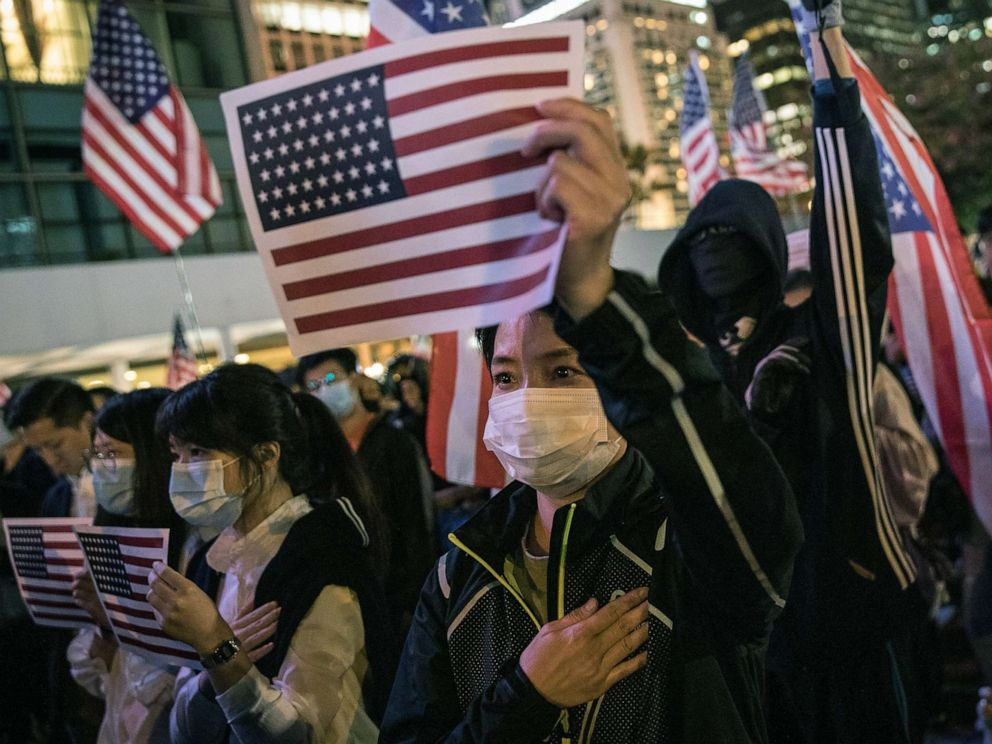 Why exuberant Hong Kong protesters are waving American ...