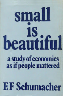Book cover saying 'small is beautiful: a study of economics as if people mattered. E.F. Schumacher.'