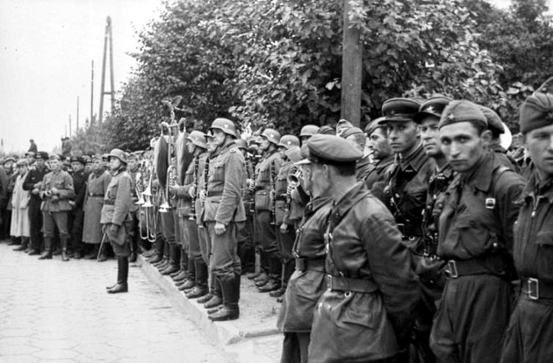 by side, German and Soviet troops watch their joint victory parade ...