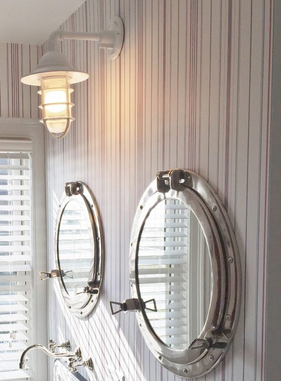 Two round port hole mirrors in bathroom