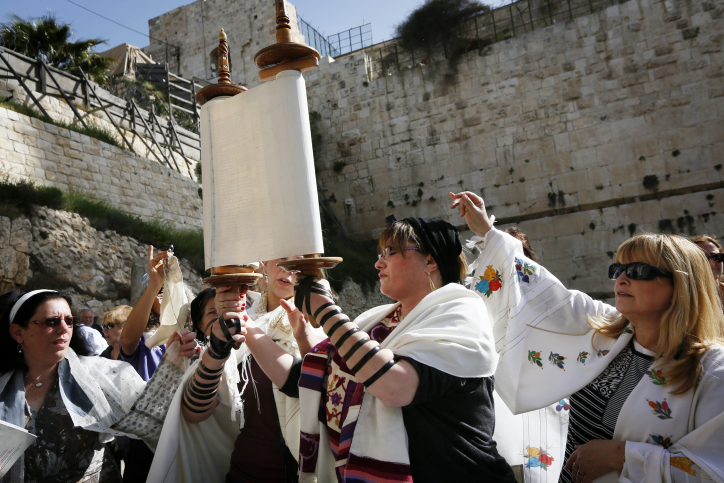 Women of the Wall wear prayer shawls as they pray at the Western Wall ...