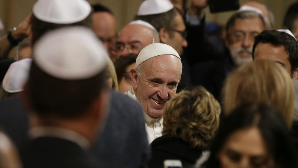 Pope Francis is greeted as he arrives at Rome's synagogue, Sunday, Jan ...