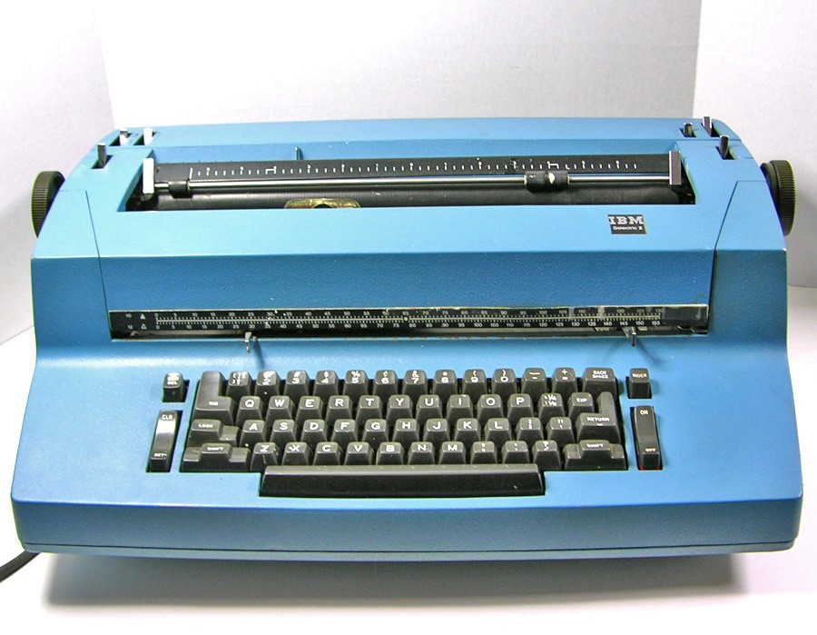 This is a heavy blue 1970 IBM Selectric II Electric Typewriter.