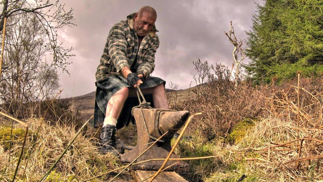 Father shows mettle to heave anvil up mountain in support ...