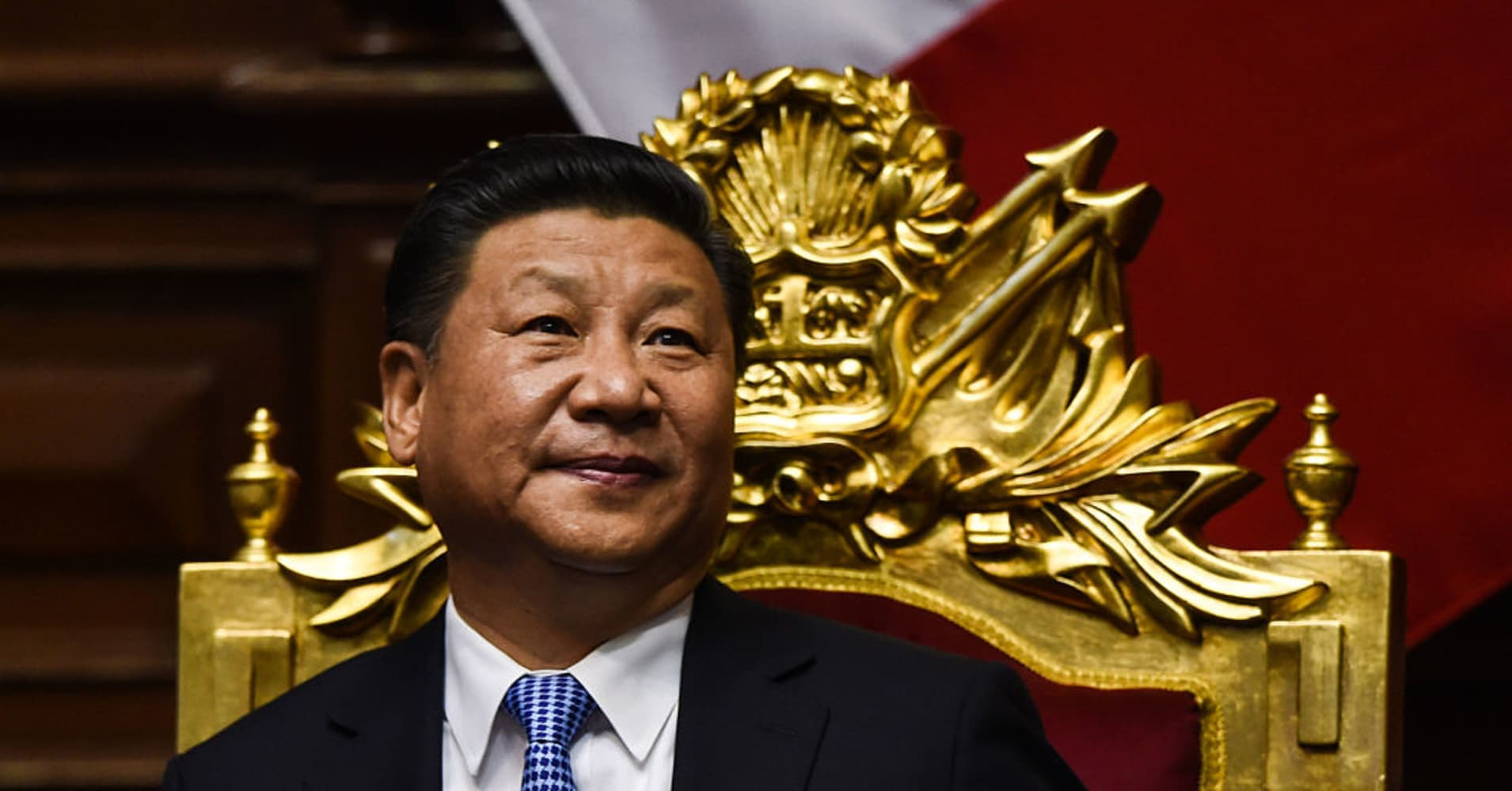China's president Xi Jinping takes to the stage at World ...