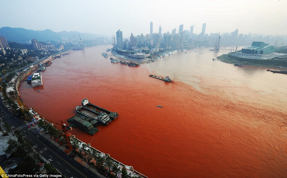 ... River (left) and the Jialin River in Chongqing, China, yesterday