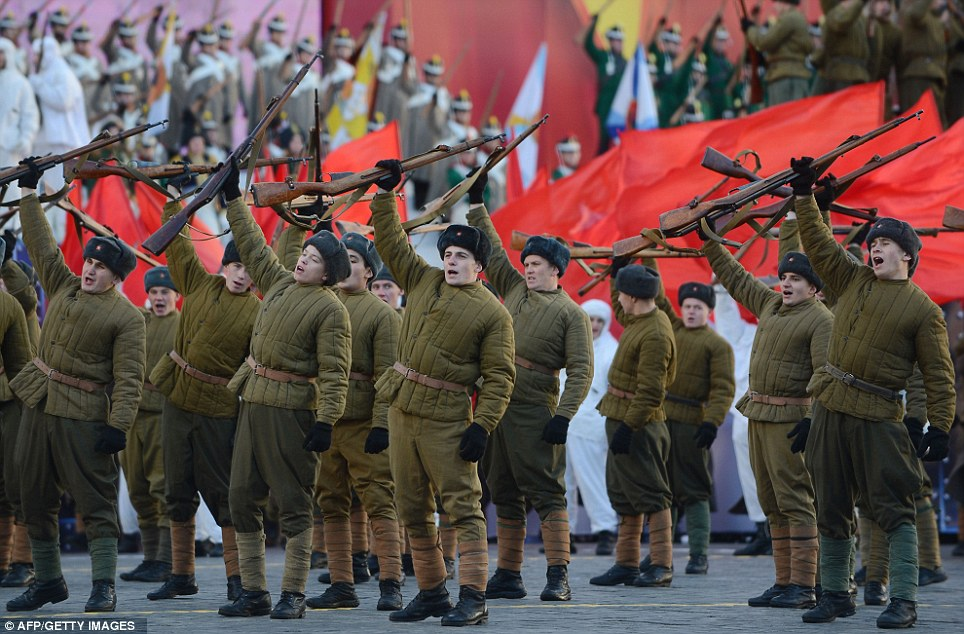 Russian soldiers don historic uniforms and march through the Red ...