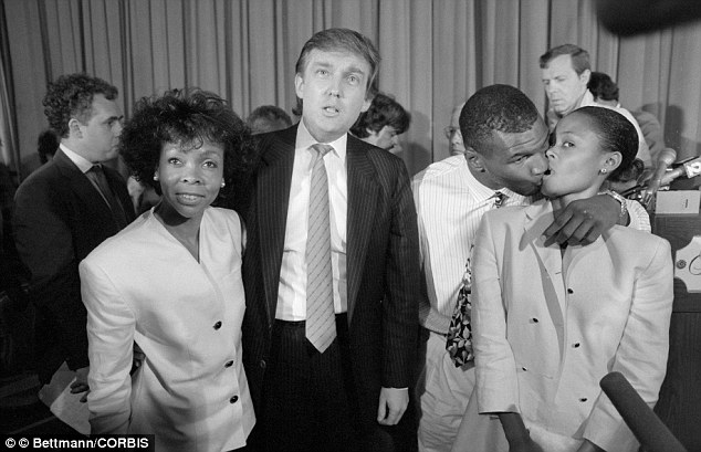Motley crew: Tyson kisses wife Robin Givens while Donald Trump and the ...