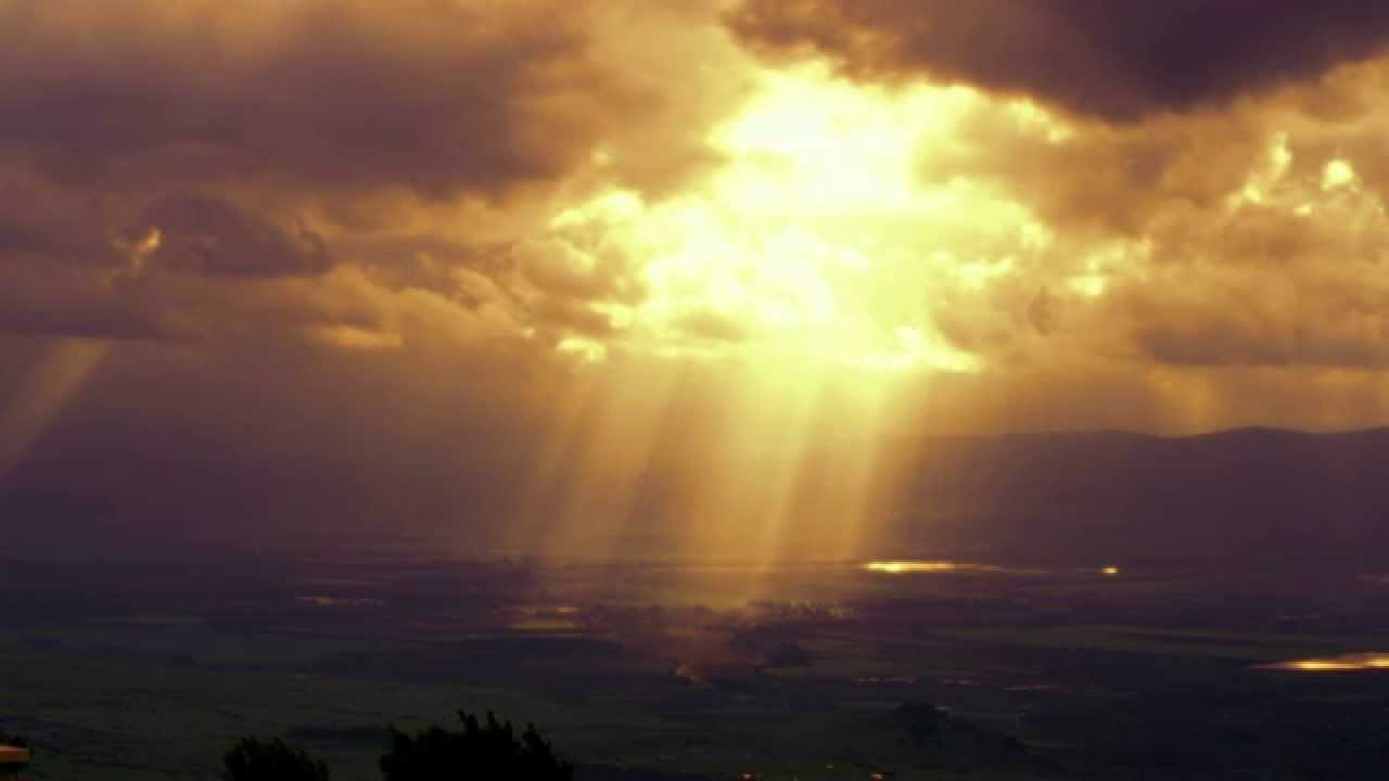 Stock Video Footage of sun rays illuminating a valley ...