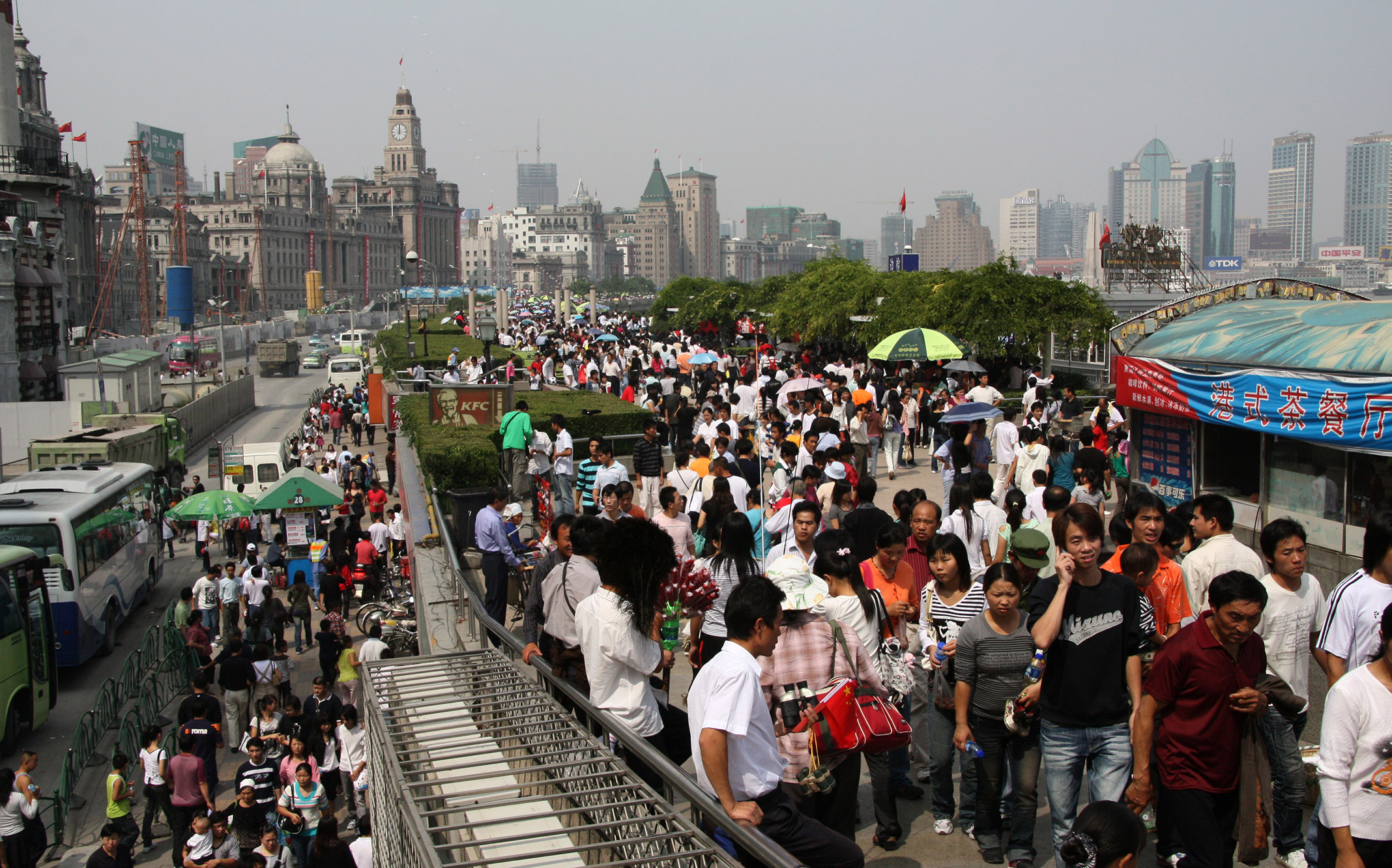 "Masses at the ""Bund"" a famous promenade near the river..."