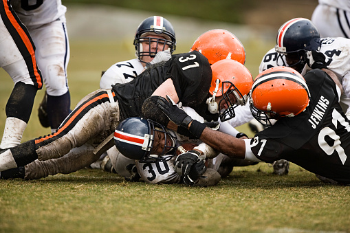 Football Player Getting Tackled