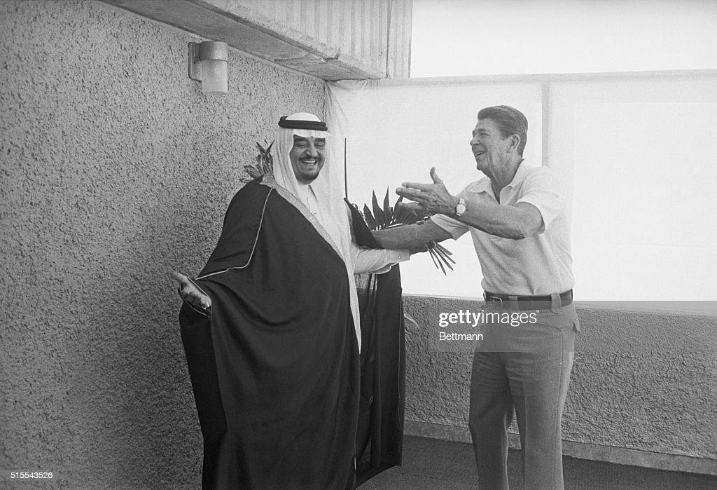 United States President Ronald Reagan gesturing to Saudi Arabian Crown ...