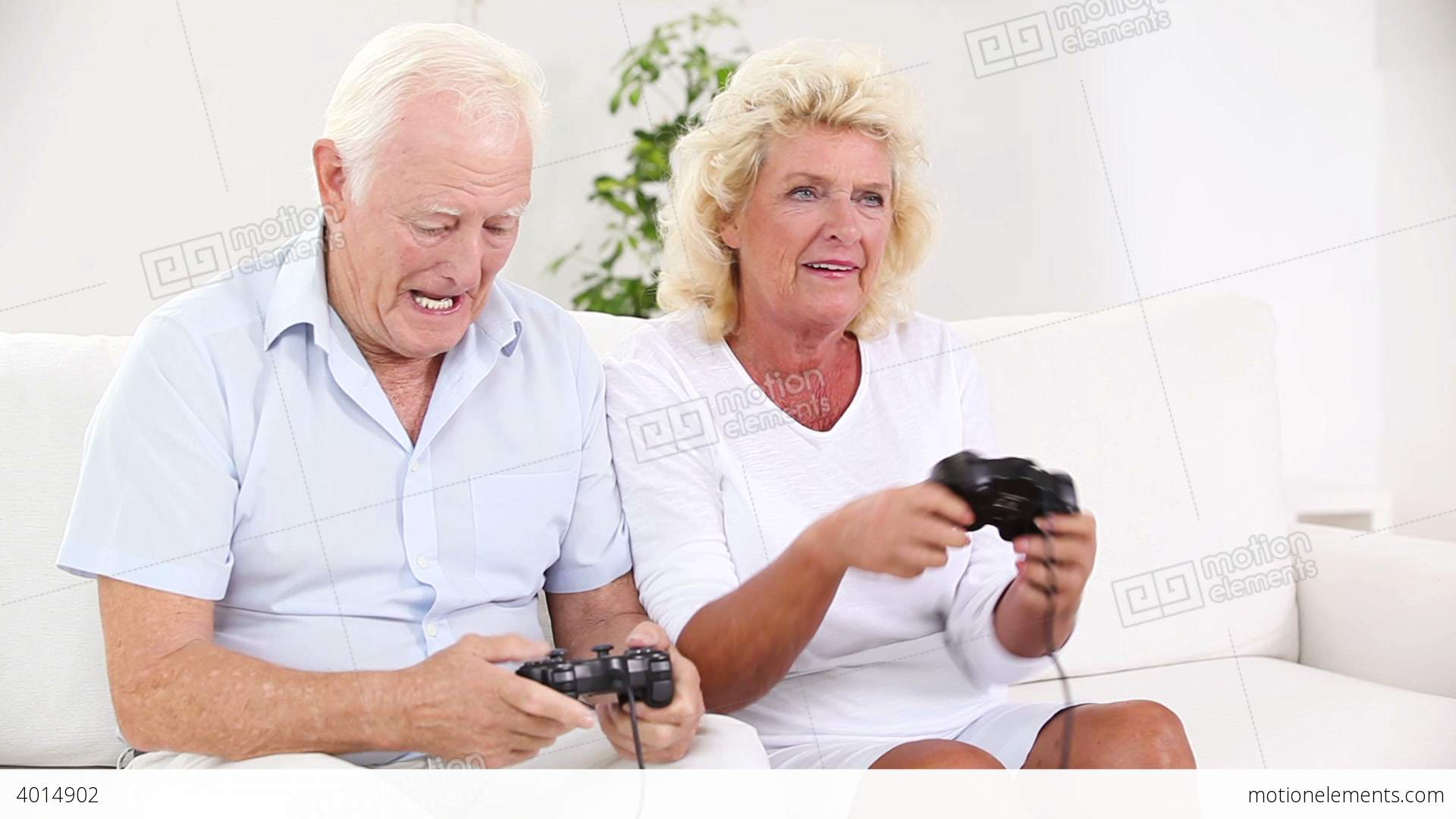 Old Couple Playing Video Games Stock video footage | 4014902
