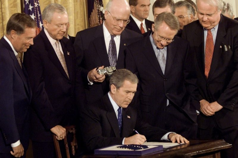 October 26, 2001, President George W. Bush Signs the ...