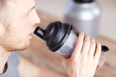 Close up of man drinking protein shake Royalty Free Stock Image