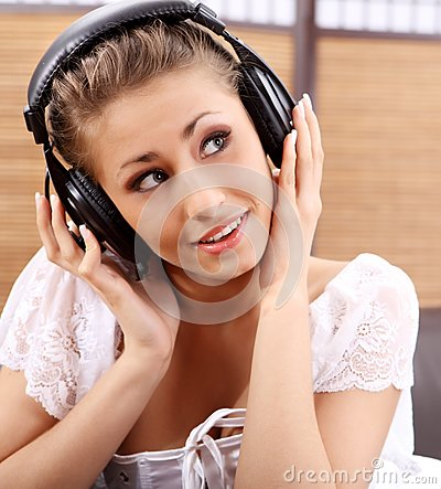 Young Sexy Women Listening Music In Headphones Stock Photography ...