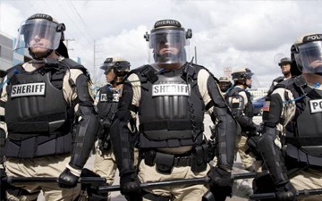 ... Obama to Ban Military-Style Gear for Police Departments - EBONY