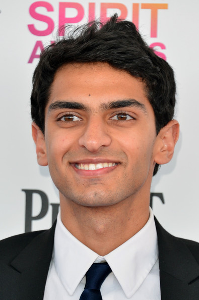 The 28-year old son of father (?) and mother(?), 180 cm tall Karan Soni in 2017 photo