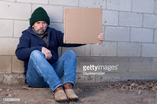 homeless-man-holding-sign-picture-id1553