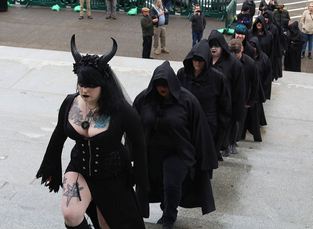 Amid pious protesters, Satanists conduct a ritual on the ...
