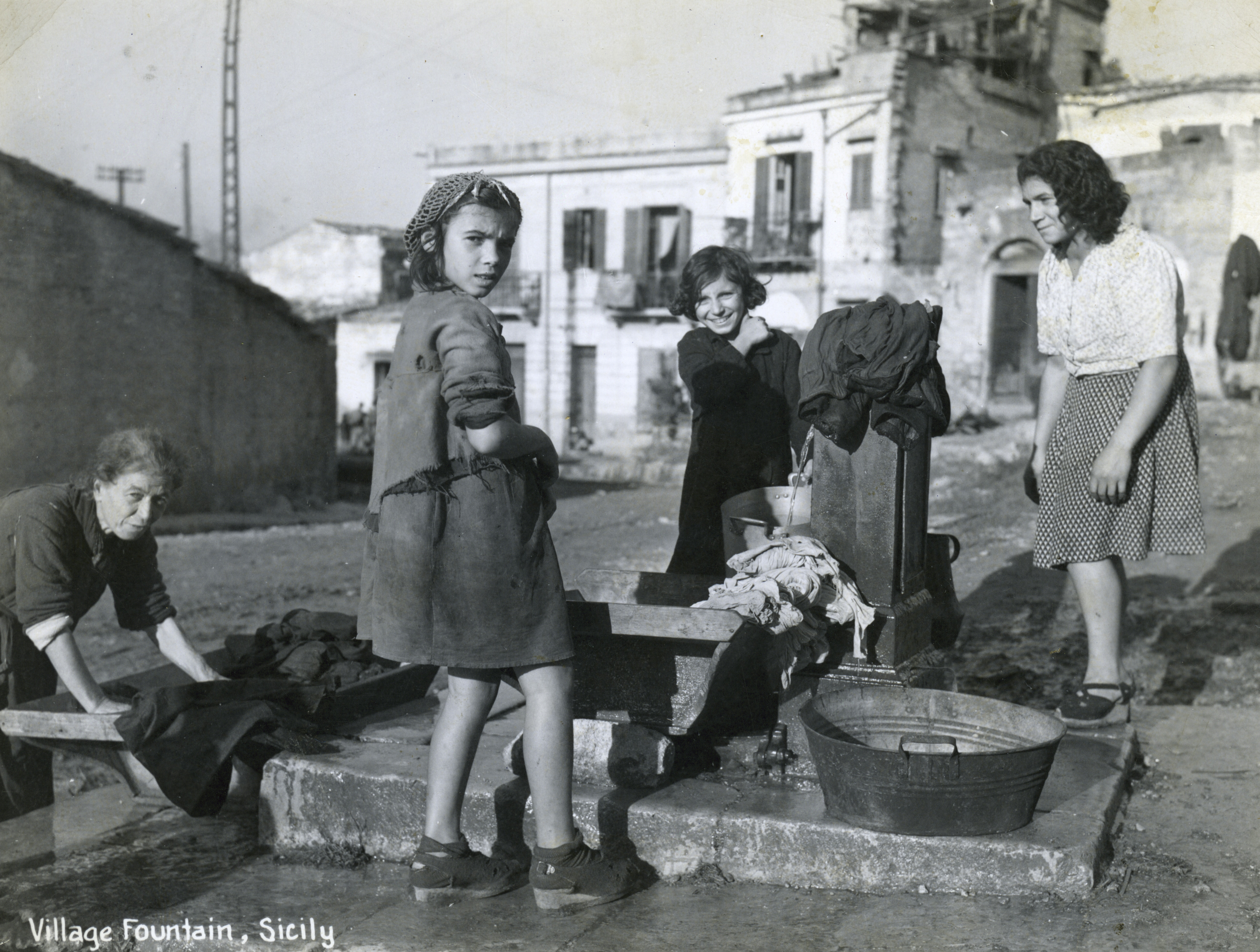Villagers at fountain in Sicily, Italy in 1944-1945 | The ...