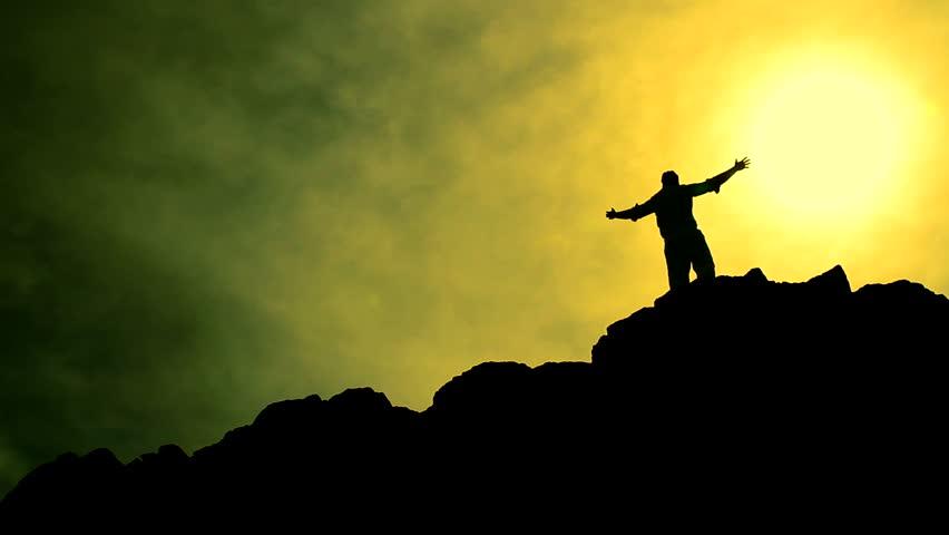 Worship Pose Silhouette Of Man On Mountain Peak Raising Religious Arms At Sun Stock Footage ...