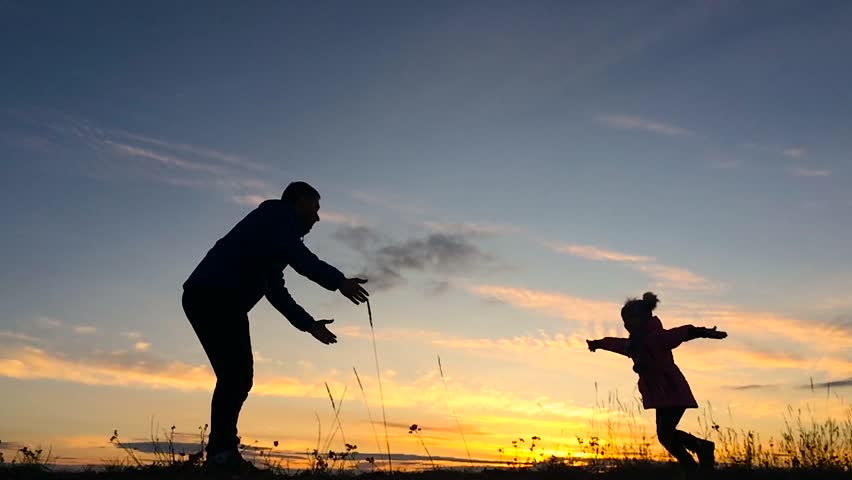 Father And Son Play In The Park During Sunset. The Concept ...