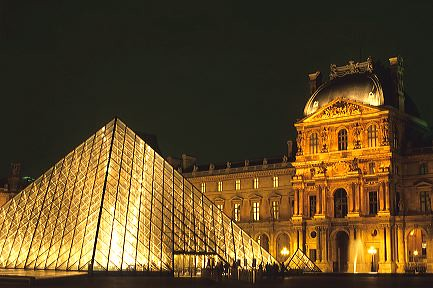 Glass pyramid at night at the entrance to the Louvre in Paris,France.
