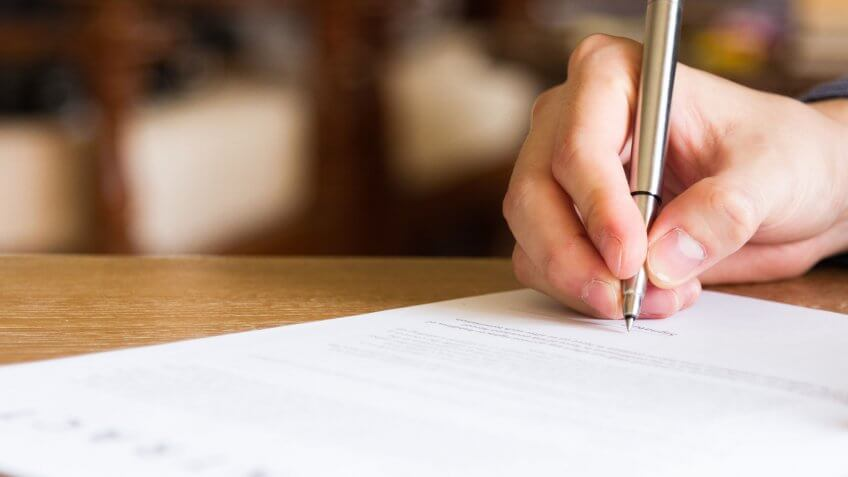 Job Seeker Signing Employment Contract in Singapore