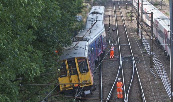 Train derailment causes commuter hell for Kings Cross ...