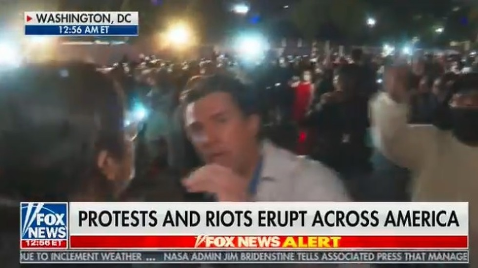 WATCH mob of protesters surrounding & shouting down Fox ...