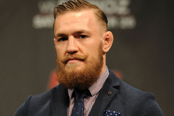 The 29-year old son of father (?) and mother(?), 175 cm tall Conor McGregor in 2018 photo