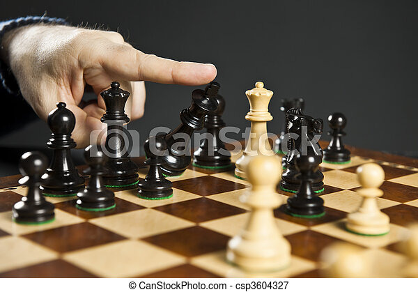 Checkmate in chess. Finger pushing over king chess piece ...