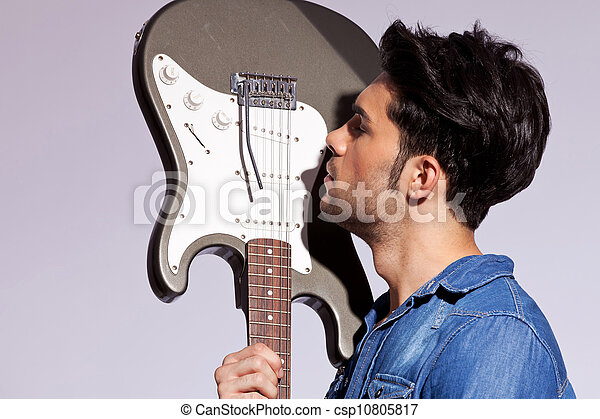 ?u=https%3A%2F%2Fcomps.canstockphoto.fr%2Fguitare-guitariste-sien-amour-image_csp10805817.jpg&f=1&nofb=1