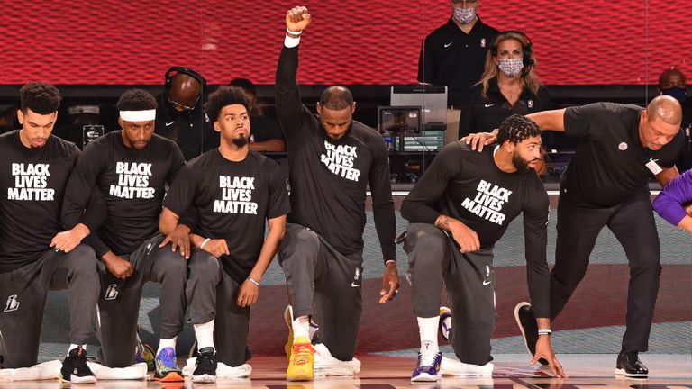 NBA players kneel during anthem in Black Lives Matter ...