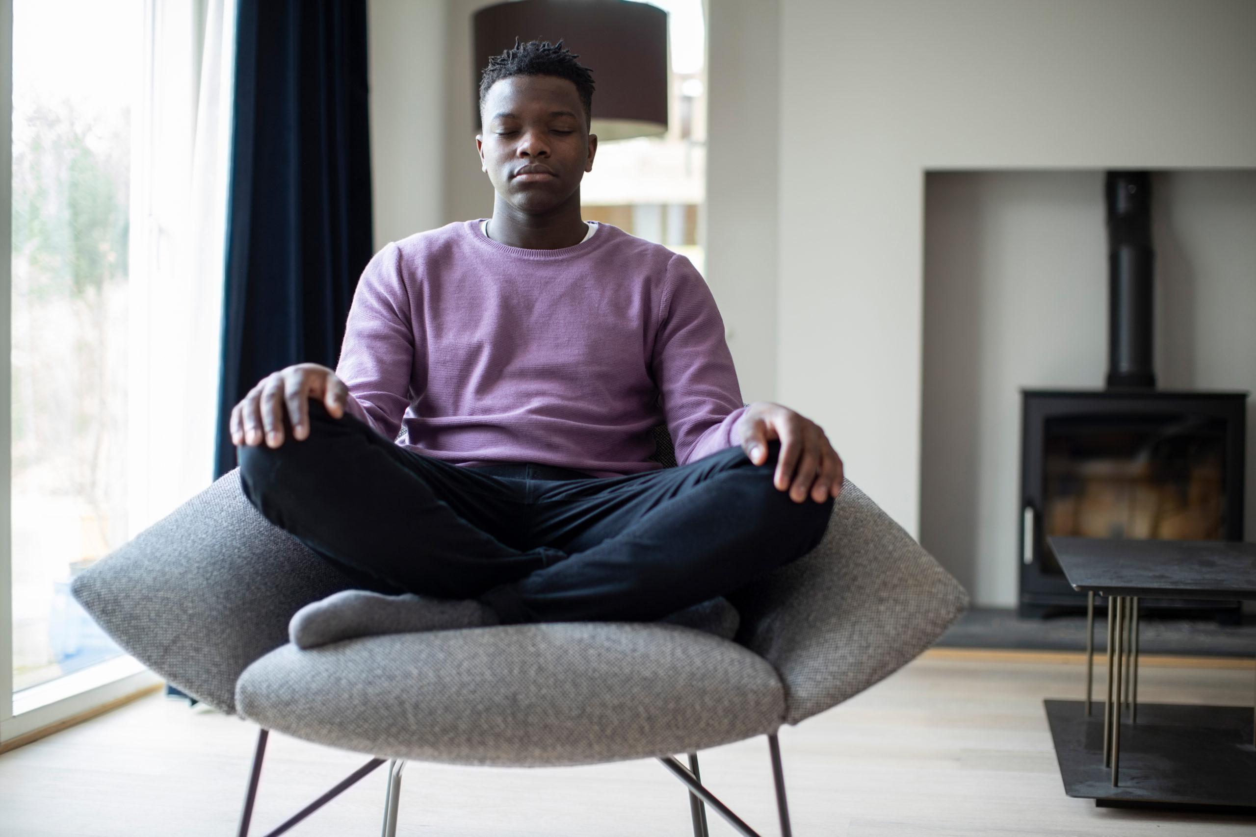 Close Up Of Peaceful Teenage Boy Meditating Sitting In ...