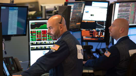 Dow jumps more than 200 points, Target and Lowe's surge on earnings