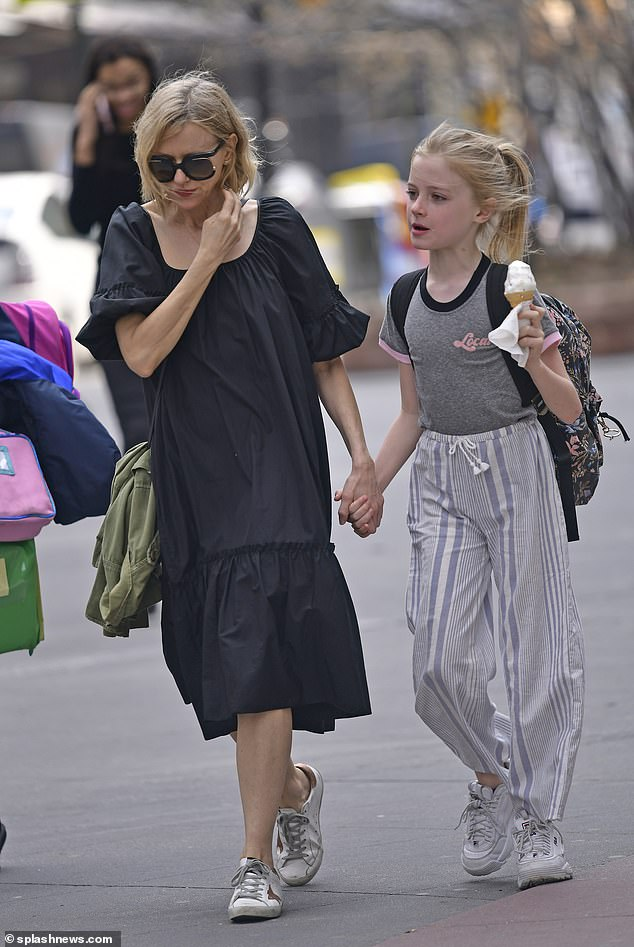 Naomi Watts looks windswept as she walks her son Samuel ...