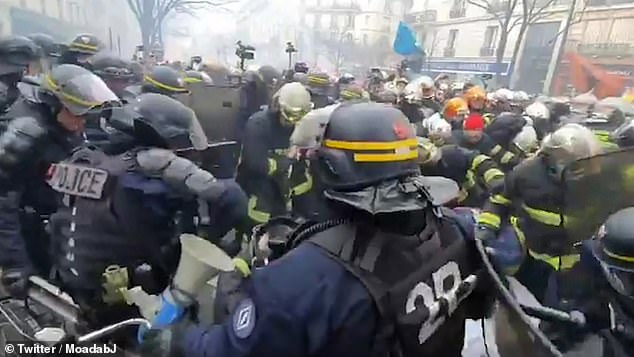 Firefighters and police battle on the streets of Paris: Riot cops engage in bitter fighting with protesters demanding better pay and conditions…