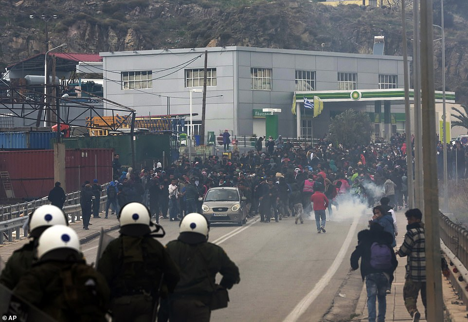 Thousands of migrants clash with police in Lesbos as tear ...