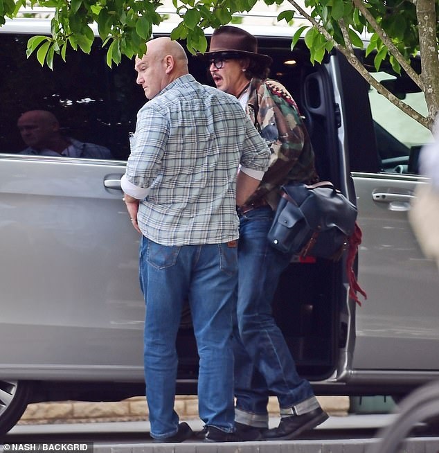 Johnny Depp is pictured arriving at pal Keith Richards ...