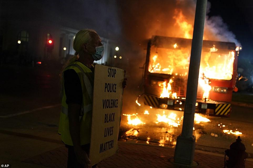 Kenosha burns: BLM protesters set light to corrections ...