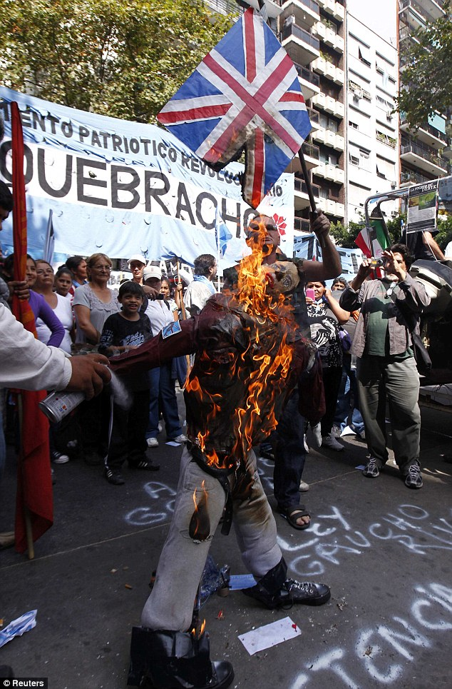 Protesters burn effigy of Prince William as mob attempts to storm the British Embassy in ...