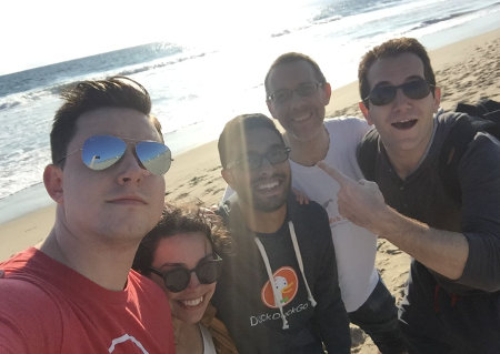 Group photo of the community team on the beach.