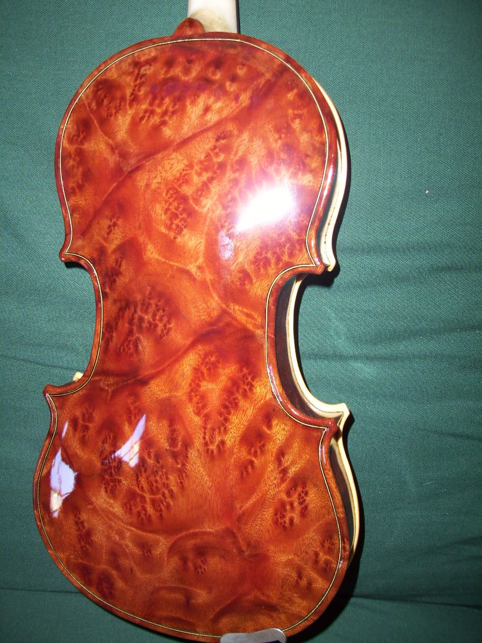 A unique violin with back/sides made from camphor burl ...