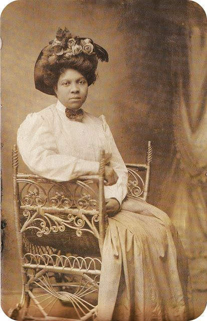 Young African American lady wearing fancy clothing, early ...