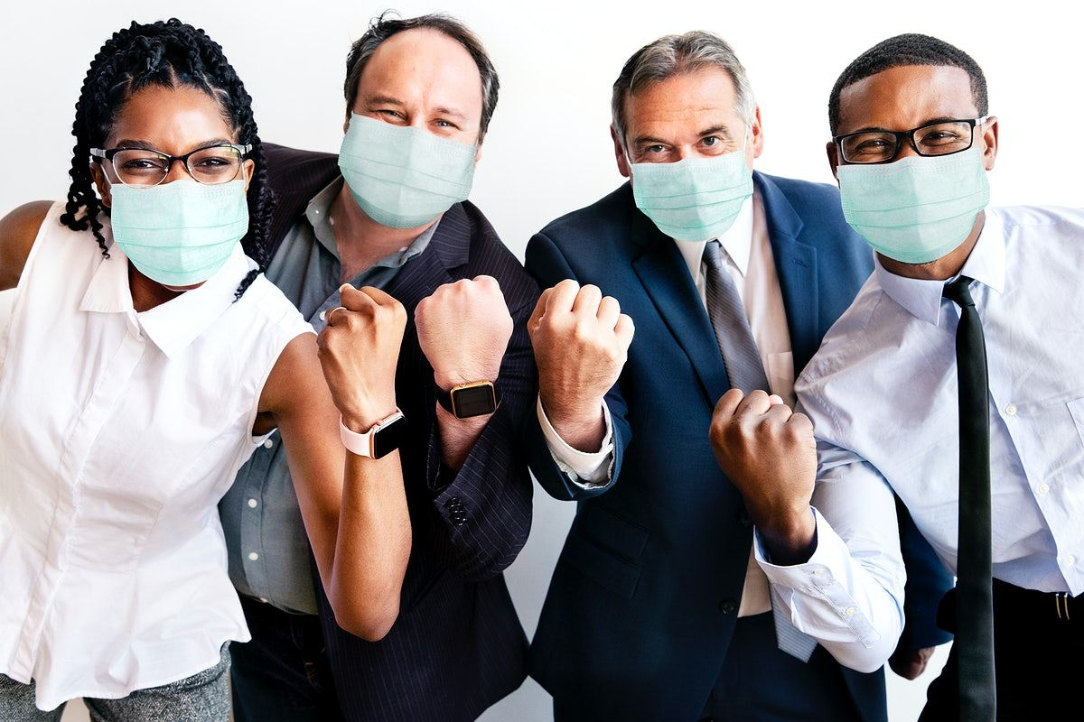 Successful business people wearing face masks at work ...