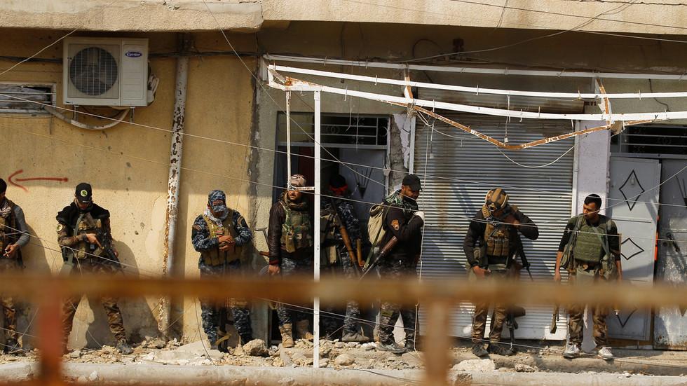 Iraqi forces raid HQ of Iran-backed militia, hand captured ...