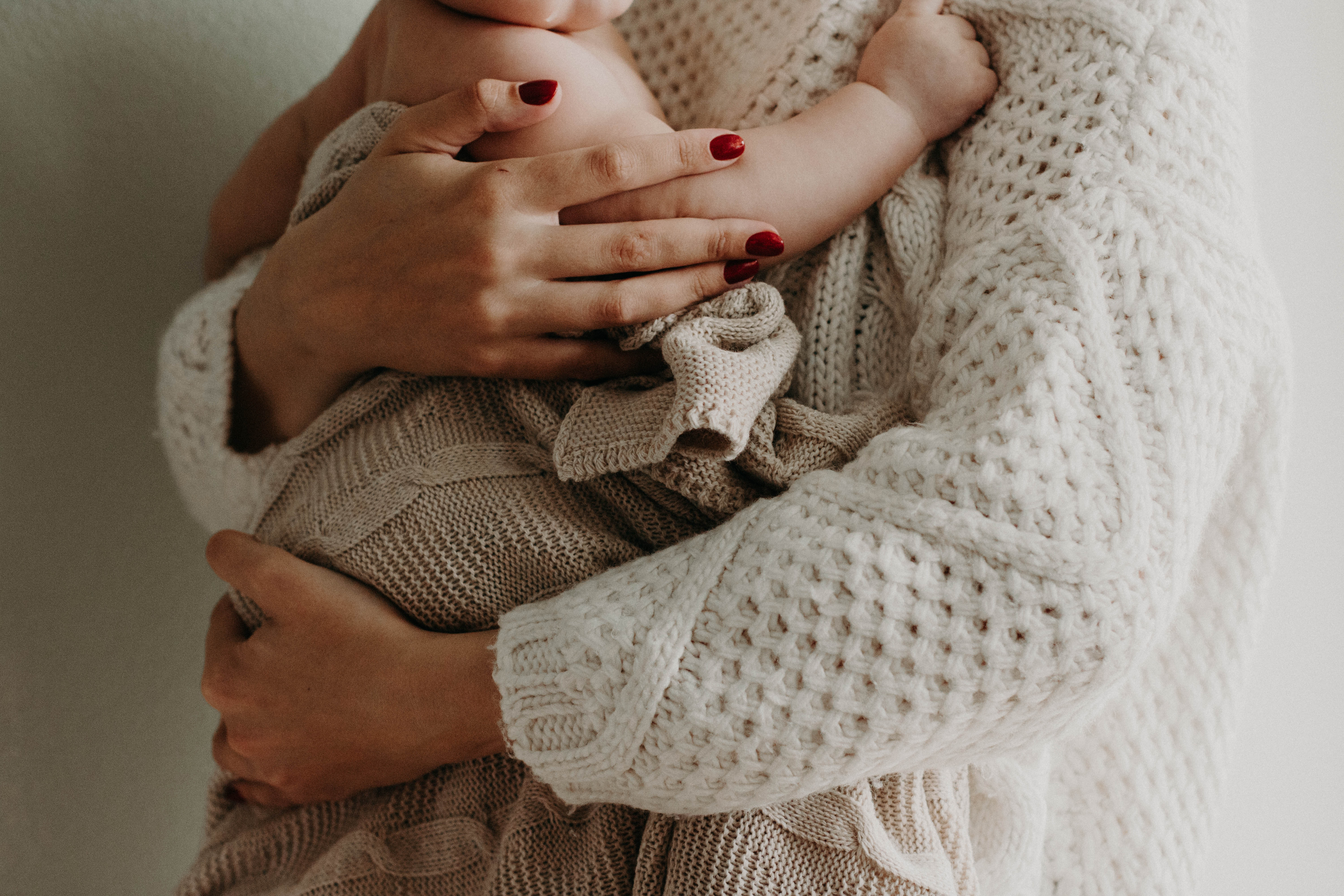 Mother Holding Her Baby · Free Stock Photo