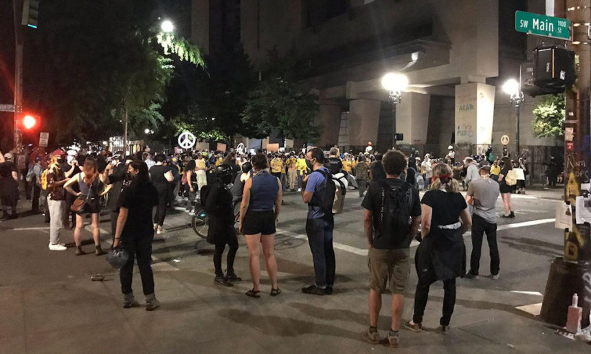 Federal officers use tear gas as fire set at Portland federal courthouse - KTVZ